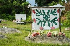 Gravestones are adorned with handmade quilts