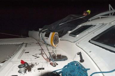 Broken mast lying across the deck, Damian trying to free the cap shroud
