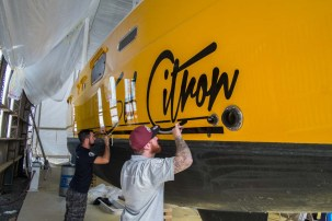 Putting the finishing touches on before leaving the shed: new signage