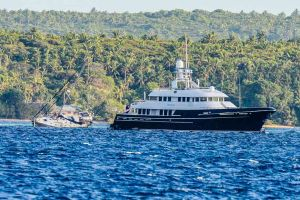 MV Dorothea hauling stranded yacht, Paje off the reef