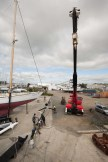 The crane getting ready to lift the mast (on the ground). Taken from the foredeck