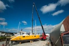 The crane positioning the mast