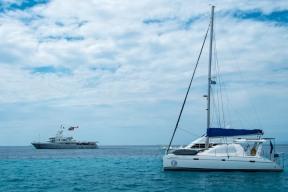 Mr Google flying in to his boat, Senses, anchored off Namotu