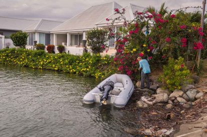 Parking Kiapa's dinghy at high tide in the suburbs